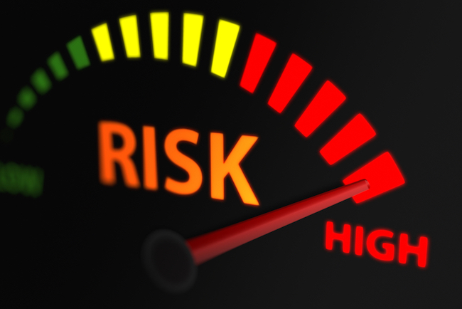 "Meter ranging from green, yellow and red with the word ""risk"" underneath it with arrow pointing towards ""high."""